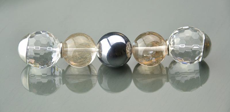 R1808026 テラヘルツ・ゴールド/ブロンズルチルクォーツ・カット水晶